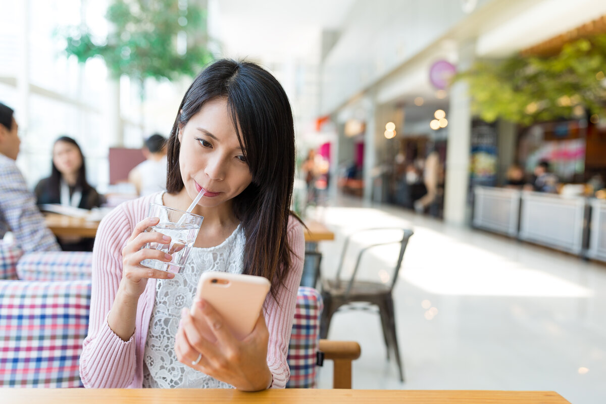 Woman use of cellphone in cafe